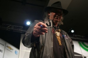 Neil Young holding the library symbol at SXSW